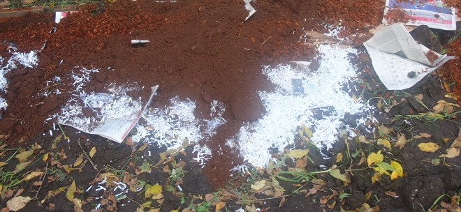 garden bed covered in peat moss, shredded paper, sheets of newspaper and leaves