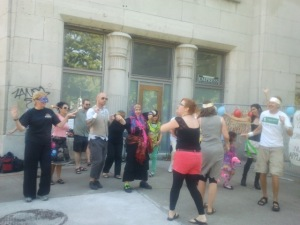 People dancing in front of the Empress building