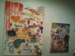 Hearts, birds, suns and stars decorate two of the oil paintings created at launch party