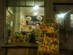 The Le Milieu Co-op at night - photo taken of co-op launch party from outside the co-op