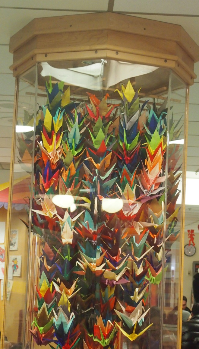 Tower of colourful origami paper whooping cranes in glass case at old Montreal Children's Hospital